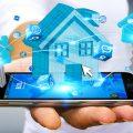 Businessman connecting digital blue house and keys